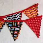 Childrens bunting handmade & personalised in the UKOur fabric superhero bunting is double sided ideal for decorating your teepee. You can personalise your bunting by adding a custom name, initials or wording of your choice. You also have a choice of tape colour to choose from. Main colours and fabrics are, red stars, black & white zig zags, orange & red zig zags, black with superhero words. See the description below for a step by step guide or contact Love My Teepee.