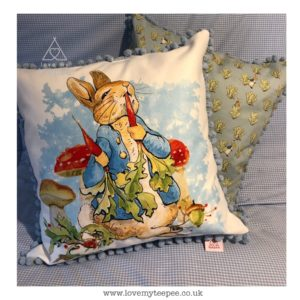Childrens peter rabbit cushion with pom pom edging