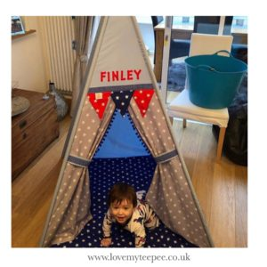 Finley playing in his rocket teepee tent