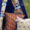 teepee tent dinosaur royal blue cushions orange dino fossil and white footprints