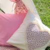 girls ivory cushion with center rose heart edged in cream lace