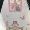 country girls teepee tent appliqued with a girl sat on a gate surounded with hedghog, rabbit, foxgloves. butterflies, bird and flowers